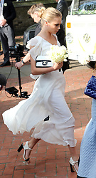 Cara Delevingne leaving her sister Poppy's  wedding at St.Paul's Church in Knightsbridge, London , Friday, 16th May 2014. Picture by Stephen Lock / i-Images