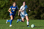 Rice's Molly McCabe (26) and Milton's Caitlyn Dabagian (10) battle for the ball during the girls soccer game between the Milton Yellowjackets and the Rice Green Knights at Rice Memorial High School on Saturday afternoon October 3, 2015 in South Burlington. (BRIAN JENKINS/ for the FREE PRESS)