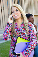 Young Woman Talking on Cell Phone at School