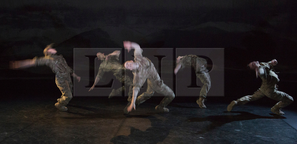 """© Licensed to London News Pictures. 07/05/2015. London, England. The company performs """"Firefight"""". The Rosie Kay Dance Company perform """"5 Soldiers: The Body is the Frontline"""" at The Rifles Officers' Club in Mayfair, London from 7 to 9 May 2015 before continuing a UK tour. 5 Soldiers gives an intimate view of the training that provides soldiers for combat and warfare and how the experience affects those that put their life on the line. Dancers: Duncan Anderson, Shelley Eva Haden, Chester Hayes, Sean Marcs and Oliver Russell. Choreographed and directed by Rosie Kay.  Photo credit: Bettina Strenske/LNP"""