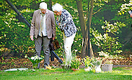 LAGE VUURSCHE  - visitors see the GRave of Prince  Friso, flowers are at the place where he is buried. Cemetery near the church where Prince Friso Stulp, the son of Beatrix buried. VUURSCHE. COPYRIGHT ROBIN UTRECHT