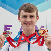 Swimming Ross Murdoch poses with his gold and bronze medal after Team Scotland's Athlete Parade through the streets of Glasgow. 15 August 2014, Kelvingrove, GLASGOW.  (c) Paul J Roberts / SportPix.org.uk(c)