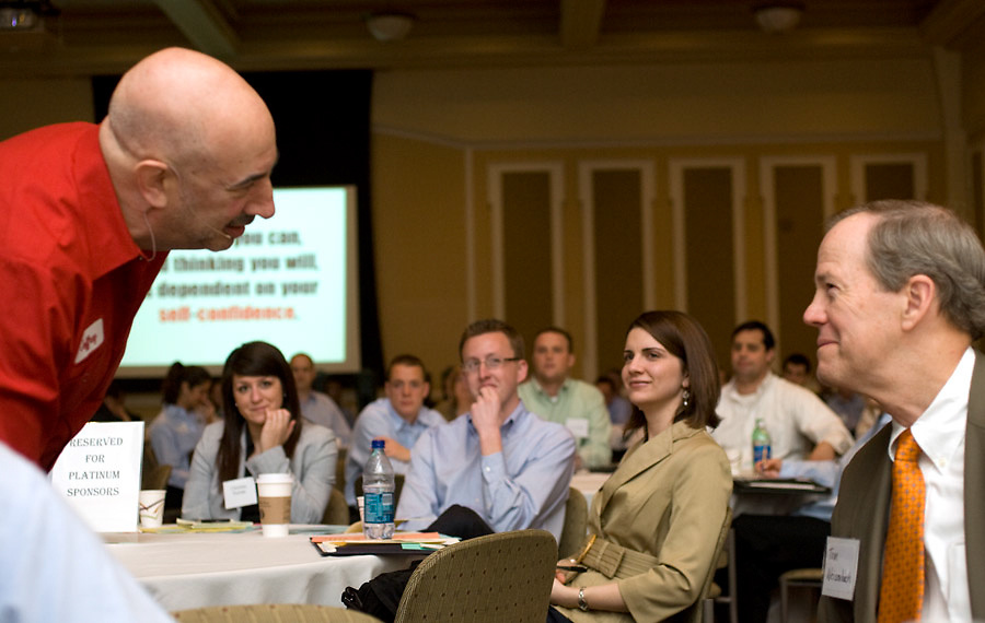 Guest Speaker Jeffrey Gitomer circulates through the crowd during the Ralph & Luci Schey Sales Symposium at Baker Center Thursday morning.