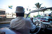 Taxi driver in classic American car, Havana, Cuba
