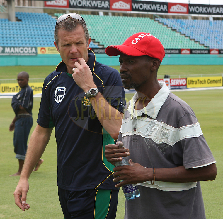 Corrie van Zyl (Coach)  with groundsman  during the South Africa and India team practice sessions held at Kingsmead Stadium in Durban on the 11 January 2011 ( The 1st ODI between South Africa and India is due to be held at Kingsmead Stadium on the 12th January 2011 )..Photo by Steve Haag/BCCI/SPORTZPICS