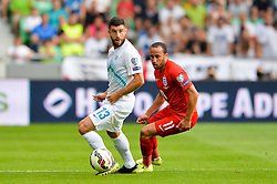 Bojan Jokic of Slovenia and Andros Townsend of England during the EURO 2016 Qualifier Group E match between Slovenia and England at SRC Stozice on June 14, 2015 in Ljubljana, Slovenia. Photo by Mario Horvat / Sportida