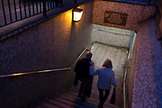 A couple descend the steps into the tunnel under London Bridge during the evening rush-hour, on 8th November 2018, in London, England.