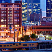 Close up of Kansas City, Missouri skyline at dusk, antique train parked in foreground, taken from Washington Square Park.
