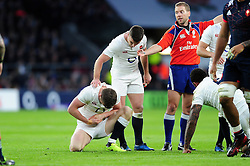 George Ford of England checks on Owen Farrell after his team-mate holds his wrist in pain after suffering an injury - Mandatory byline: Patrick Khachfe/JMP - 07966 386802 - 04/02/2017 - RUGBY UNION - Twickenham Stadium - London, England - England v France - RBS Six Nations Championship 2017.