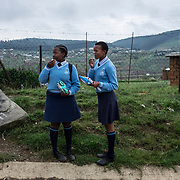 Young girls are walking in the streets after the end of their school day in Vilundlela, in KwaZulu Natal. Nearly a third of all new HIV infections in South Africa occur in 15-24 year olds with adolescent girls being up to eight times more likely to be infected with HIV that their male counterparts. An estimated 2000 South African young women between the age of 15-24 years get infected with HIV every week. Vulindlela, South Africa.  7 November 2017. © Miora Rajaonary / Wall Street Journal