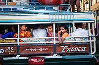 A crowded jeep at a bus station in Mandalay, Myanmar.