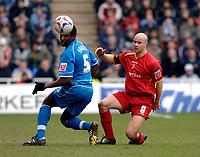 Photo: Daniel Hambury.<br />Reading v Watford. Coca Cola Championship. 11/03/2006.<br />Reading's Ibrahima Sonko (L) and Watford's Gavin Mahon battle.