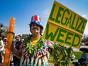 "20 APRIL 2016 - ST. PAUL, MN: A man who identified himself as ""Cool Breeze"" at a marijuana legalization rally in St. Paul. About 100 people gathered at the Minnesota State Capitol in St. Paul and marched through downtown St. Paul calling for the decriminalization of marijuana. April 20 (4/20) has become a sort of counter culture holiday in the US, with marches in many cities calling for the legalization of marijuana.      PHOTO BY JACK KURTZ"