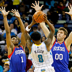 November 7, 2012; New Orleans, LA, USA; Philadelphia 76ers shooting guard Nick Young (1) and center Spencer Hawes (0) defend against New Orleans Hornets shooting guard Roger Mason Jr. (8) during the second half of a game at the New Orleans Arena. The 76ers defeated the Hornets 77-62. Mandatory Credit: Derick E. Hingle-US PRESSWIRE