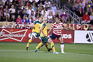 September 19, 2012 Commerce City, CO.  USA f Alex Morgan (13) tries to get past the Australian defense during the Soccer Match between the USA Women's National Team and the Women's Australian team at Dick's Sporting Goods Park in Commerce City, Colorado