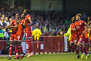 Beryly Lubula (Crawley Town)  celebrating his gaol with Nathan Ferguson (Crawley Town) and Panutche Camara (Crawley Town) with David Sesay (Crawley Town) and Josh Doherty (Crawley Town) on their way to join the celebration during the EFL Cup match between Crawley Town and Norwich City at The People's Pension Stadium, Crawley, England on 27 August 2019.