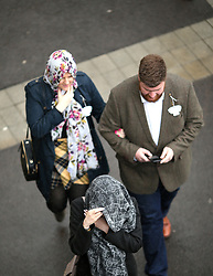 Racegoers arrive ahead of The Gold Cup Day of the 2019 Cheltenham Festival at Cheltenham Racecourse.