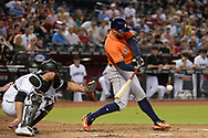 PHOENIX, AZ - AUGUST 15:  George Springer #4 of the Houston Astros hits a two run double in the second inning against the Arizona Diamondbacks at Chase Field on August 15, 2017 in Phoenix, Arizona.  (Photo by Jennifer Stewart/Getty Images)