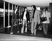 """Arrivals of Eric Clapton and Judy Geeson at DAP..1975..13.09.1975..09.13.1975..13th September 1975..Today saw the arrivals of musician Eric Clapton and actress Judy Geeson at Dublin Airport. They are in Ireland to take part in """"Circasia 75"""" at Straffan House,Co Kildare..Image shows the arrival of Eric Clapton at the airport ,he was accompanied by Patti Harrison and his road manager Mike Turner as they strolled from the aircraft."""