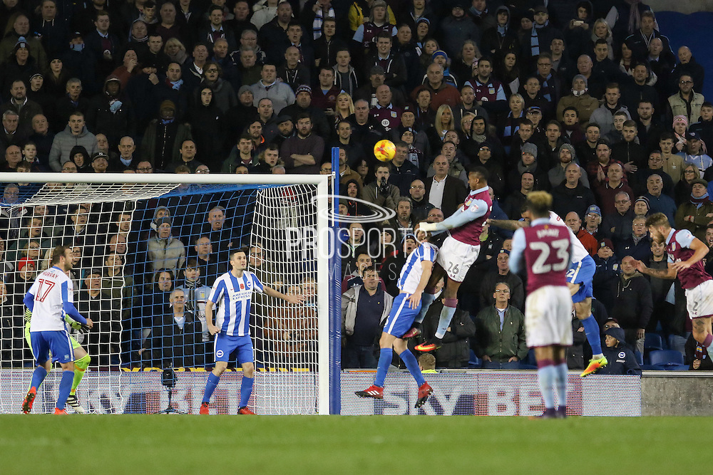 Aston Villa striker Jonathan Kodjia (26) heads at goal during the EFL Sky Bet Championship match between Brighton and Hove Albion and Aston Villa at the American Express Community Stadium, Brighton and Hove, England on 18 November 2016. Photo by Phil Duncan.