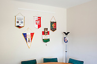 SAN MARINO, SAN MARNO - 3 OCTOBER 2011:Pennants exchanged with European teams are hanged in the San Marino Soccer Federation headquarters in San Marino, San Marino on October 3, 2011. The San Marino national football team is the last team in the FIFA  World Ranking (position 203). San Marino, whose population reaches 30,000 people, has never won a game since the team was founded in 1988. They have only ever won one game, beating Liechtenstein 1–0 in a friendly match on 28 April 2004. The Republic of San Marino, an enclave surronded by Italy situated on the eastern side of the Apennine Moutanins, is the oldest consitutional republic of the world<br /> <br /> <br /> ph. Gianni Cipriano