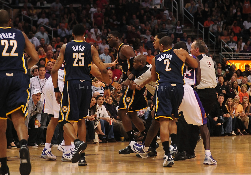 Phoenix, AZ, USA; Indiana Pacers guard Earl Watson (2) and Phoenix Suns guard Jason Richardson (23) fight as referees attempt to break up the scuffle in the second half at the US Airways Center. Mandatory Credit: Jennifer Stewart-US PRESSWIRE