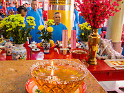 "09 FEBRUARY 2014 - HAT YAI, SONGKHLA, THAILAND:  Men light pray in the Chao Mae Tubtim Shrine (Ruby Goddess Shrine) on 108 Hainanese Ancestors Memorial Day in Hat Yai, Songkhla, Thailand. Hainanese communities around the world celebrate ""108 Hainanese Ancestors Memorial Day."" The day honors the time when 109 Hainanese villagers fleeing life in Hainan (an island off of the southwest coast of China, near Vietnam) washed up in what is now Vietnam and were killed by Vietnamese authorities because authorities thought they were pirates. The Vietnamese built a temple on the site and named it ""Zhao Yin Ying Lie."" Many Vietnamese fisherman credit prayers at the temple to saving their lives during violent storms and now ""108 Hainanese Ancestors Memorial Day"" is celebrated in Hainanese communities around the world. Hat Yai, the economic center of southern Thailand has a large Hainanese population.   PHOTO BY JACK KURTZ"