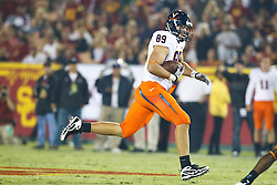September 11, 2010; Los Angeles, CA, USA;  Virginia Cavaliers tight end Colter Phillips (89) rushes up field after a pass reception against the Southern California Trojans during the second quarter at the Los Angeles Memorial Coliseum. USC defeated Virginia 17-14.