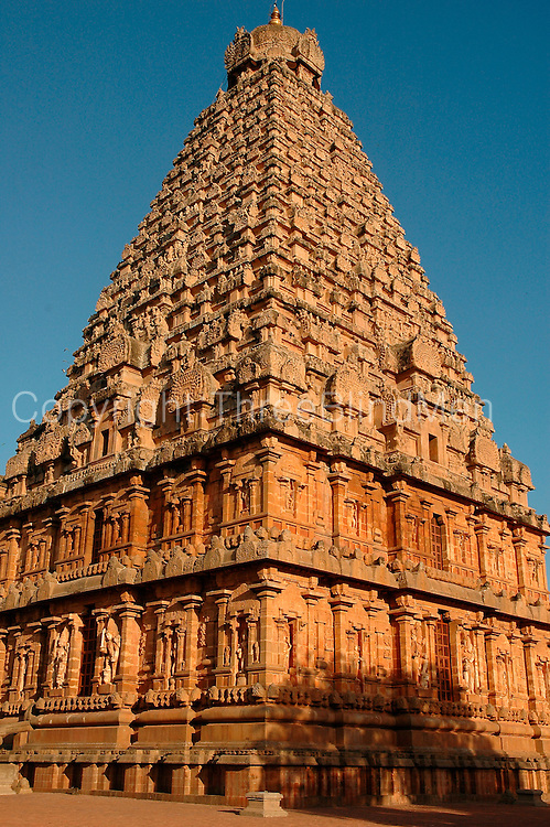 "The Brihadishwara Temple  also known as Rajarajeswaram, at Thanjavur, is the world's first complete granite temple and a brilliant example of the major heights achieved by Cholas in temple architecture. It is a tribute and a reflection of the power of its patron RajaRaja Chola I. It remains as one of the greatest glories of Indian architecture. The temple is part of the UNESCO World Heritage Site ""Great Living Chola Temples"" and this temple is an ultimate testimonial for the vishwakarmas architectural cognizence in planning and sculpting this temple..This temple is one of India's most prized architectural sites. The temple stands amidst fortified walls that were probably added in the 16th century. The 'Vimana' - or the temple tower - is 216 ft (66 m) high [4] (about 70 meters) and is among the tallest of its kind in the world. The Kalash or 'Shikhara' (apex or the bulbous structure on the top) of the temple is of monolithic granite weighing 81.25 tons. There is a big statue of Nandi (sacred bull), carved out of a single rock, at the entrance measuring about 16 feet long and 13 feet high. The entire temple structure is made out of hard granite stones, a material sparsely available currently in Thanjavur area where the temple is located."