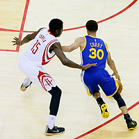 25 May 2015: Golden State Warriors guard Stephen Curry (30) drives past Houston Rockets center Clint Capela (15) during the Houston Rockets 128-115 victory over the Golden State Warriors, in game 4 of the Western Conference finals, at the Toyota Center, Houston, Texas, USA.