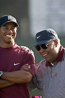 12 December 2004: Tiger Woods closed out the final round of golf with 5-under-par 66 for a two-shot victory over Padraig Harrington (Ireland) at the 2004 Target World Challenge Presented by Williams held at the Sherwood Country Club in Thousand Oaks, CA.  Tiger here with his father Earl Woods on the 18th hole smiling and sharing a moment after Tiger won the tournament..