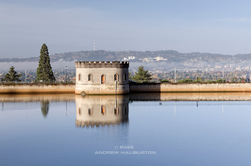 Gatehouse 5 and reflections on Reservoir 5, with the City of Portland beyond.  This is one of three open reservoirs at Mount Tabor Park, and of five total in Portland.  The 3 open reservoirs in Mount Tabor Park, with their ancillary structures, were placed in the National Register of Historic Places on January 15, 2004.  Environmental Protection Agency (EPA) regulation: Long Term 2 Enhanced Surface Water Treatment Rule, referred to as the LT2 rule imposes new requirements that open water reservoirs be covered, buried or additionally treated.  This applies to Portland's five open reservoirs and to the unfiltered Bull Run source supplying them.