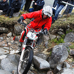 Carl Hollis England  tries hard to negotiate the heavy boulders on the lagnaha section near duror in argyll.  The six day trial pits man and machine against the heavy highland terrain with the winner having he best times on each of the stages at the end of the six days. picture kevin mcglynn | STOCKPIX