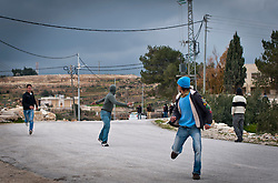 © London News Pictures. 14/03/2011. Youths throw stones at Israeli soldiers in the Palestinian village of Al ma' sara just outside Bethlehem in the occupied West Bank. Villagers protested against the continued building of Israeli settlements on Palestinian land. 13/03/11