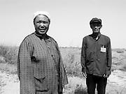 Man and woman at desert reclaimation project, Ningxia, China