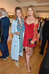 Left to right, The HON.ISABEL DOUGLAS-HAMILTON and FLORA OGILVY at a private view of photographs by Jolyon Fenwick 'The Zero Hours Panoramas' 100 Years On: Views From The Parapet of The Somme held at Sladmore Contemporary, 32 Bruton Place, London on 30th June 2016.