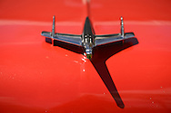 Floral Park, New York, U.S. - April 27, 2014 - A red 1955 Chevrolet Bel Air with Nomad hood ornament is exhibited at the 35th Annual Antique Auto Show at Queens Farm.