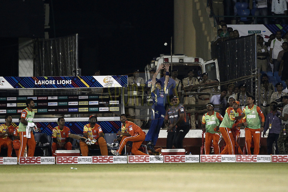 Michael Hussey of the Mumbai Indians trying to take catch on boundary during the qualifier 2 match of the Oppo Champions League Twenty20 between the Mumbai Indians and the Lahore Lions held at the Chhattisgarh International Cricket Stadium, Raipur, India on the 13th September 2014<br /> <br /> Photo by:  Deepak Malik / Sportzpics/ CLT20<br /> <br /> <br /> Image use is subject to the terms and conditions as laid out by the BCCI/ CLT20.  The terms and conditions can be downloaded here:<br /> <br /> <br /> http://sportzpics.photoshelter.com/gallery/CLT20-Image-Terms-and-Conditions-2014/G0000IfNJn535VPU/C0000QhhKadWcjYs