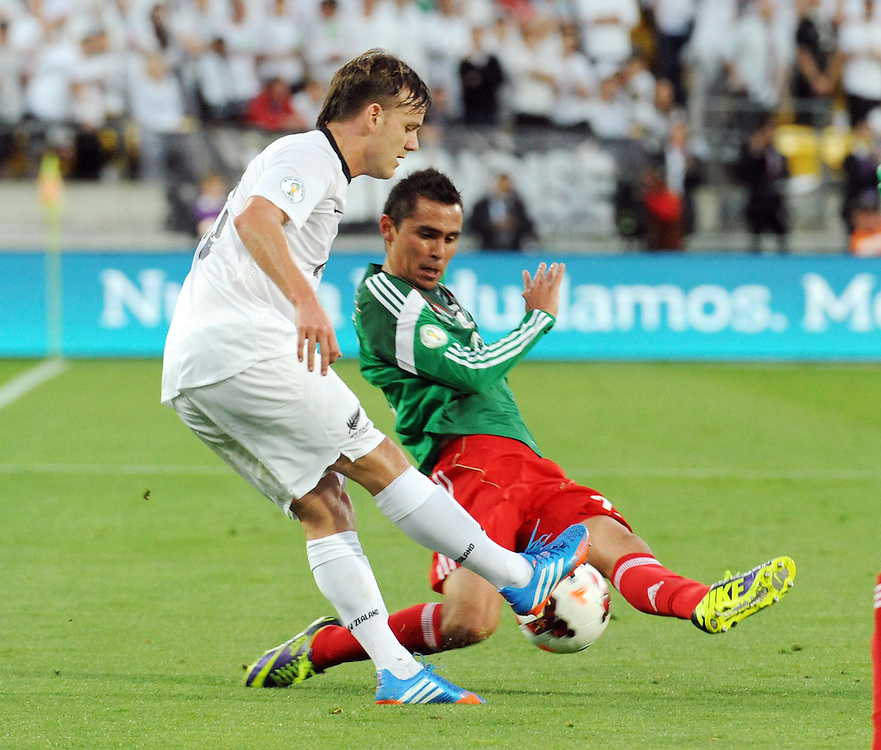 Mexico's Paul Aguilar, right, against puts a tackle on New Zealand's Chris James in the World Cup Football qualifier, Westpac Stadium, Wellington, New Zealand, Wednesday, November 20, 2013. Credit:SNPA / Ross Setford