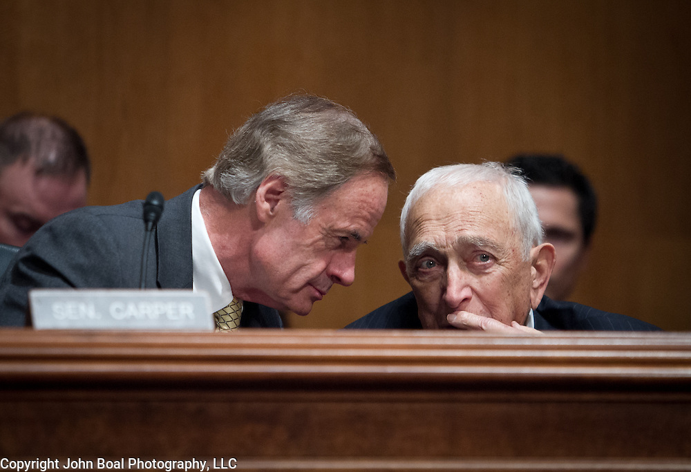 Sen. Tom Carper (D-DE), left and Frank Lautenberg (D-NJ) have a few words during a hearing  to vote for an Obama administration nominee on Thursday, May 16, 2013.  Sen. Lautenberg (D-NJ), returned to Washington DC  for the first time since February 28, as weakness in his legs has prevented him from traveling to the Capitol.  He died only a few weeks later, on June 3, 2013.  John Boal photography