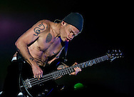 Red Hot Chili Peppers bassist Flea performs with the band during their headlining performance on the third day of the 2013 Coachella Valley Music and Arts Festival in Indio, Calif. Sunday.