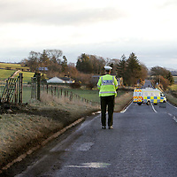 Five dead in a road traffic accident on the A85 Perth to Crieff road near Burnbrae garage.<br />A police officer at the scene of last night's crash, the only visible signs is the scorched verge.<br />Picture by Graeme Hart.<br />Copyright Perthshire Picture Agency<br />Tel: 01738 623350  Mobile: 07990 594431