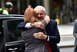 """RETRANSMITTED WITH ADDITIONAL INFORMATION Labour leader Jeremy Corbyn receives a hug from his Office Director Karie Murphy as he arrives at Labour Party HQ in Westminster, London, after he called on the Prime Minister to resign, saying she should """"go and make way for a government that is truly representative of this country""""."""
