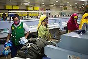 Garment workers at work on machines inside  Epyllion Group garment factory in Bangladesh.