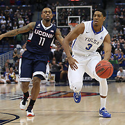 Shaquille Harrison, (right), Tulsa, drives past Ryan Boatright, UConn, during the UConn Huskies Vs Tulsa Semi Final game at the American Athletic Conference Men's College Basketball Championships 2015 at the XL Center, Hartford, Connecticut, USA. 14th March 2015. Photo Tim Clayton