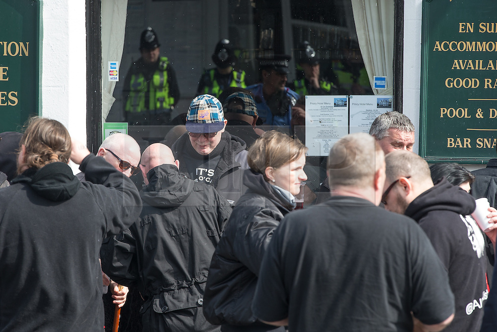 © Licensed to London News Pictures . 02/04/2016 . Dover , UK . Far-right protesters gather outside the Priory Hotel opposite Dover Priory Station . Demonstrations by far-right groups (including The National Front , The North West Infidels and The South East Alliance ) and , opposing them , anti-fascists , close to the port of Dover in Kent . Photo credit : Joel Goodman/LNP