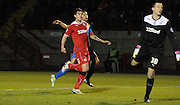 Joe Walsh and Lewis Price look on helplessly as Nathan Tyson's lobbed shot hits the back of the net during the Sky Bet League 1 match between Crawley Town and Doncaster Rovers at Broadfield Stadium, Crawley, England on 10 February 2015. Photo by Michael Hulf.