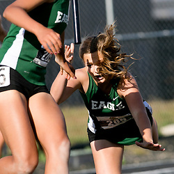 An Eagle High School runner falls and loses the baton during a transfer in the girls 4x100m race during the 5A District 3 Track and Field meet at Meridian High School in Meridian, Idaho. May 08, 2015