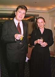 The HON.CHRISTOPHER & MRS TENNANT, he is the son of Lord Glenconner, at a lunch in london on 10th December 1998.MMW 19