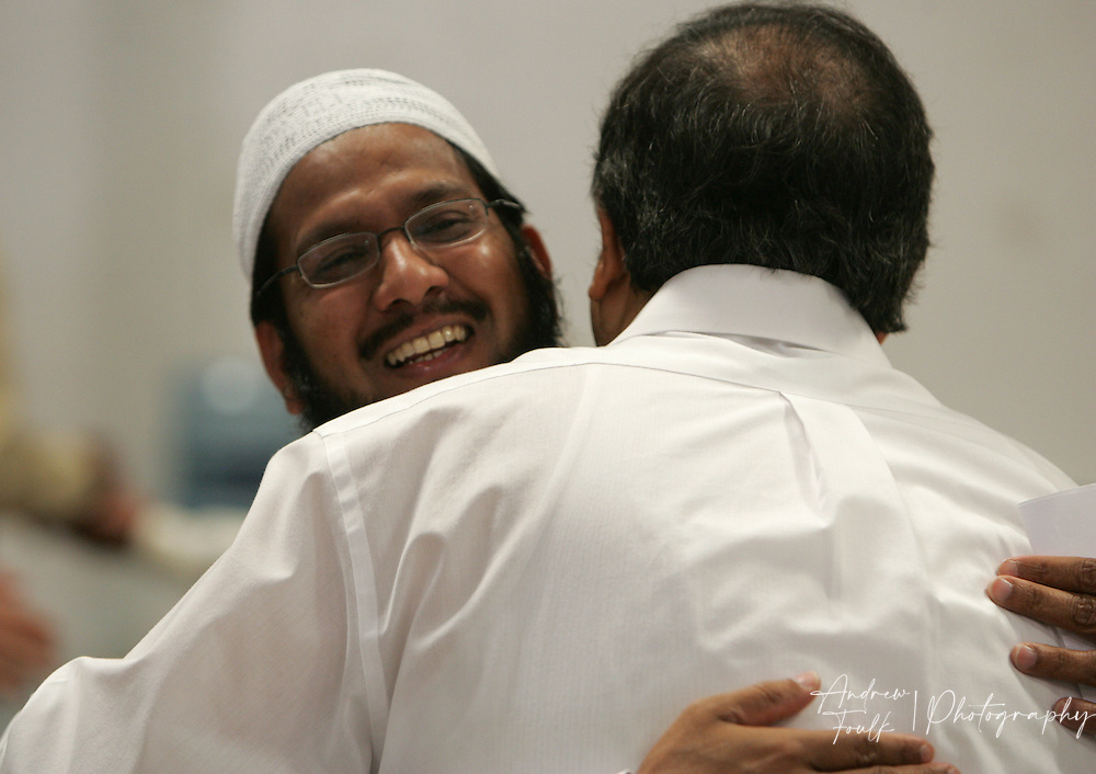 /Andrew Foulk/For The Californian/.Muhammad Ansari, hugs a fellow worshiper at the Islamic Center of Temecula Sunday morning after the end of services for the final day of Ramadan.